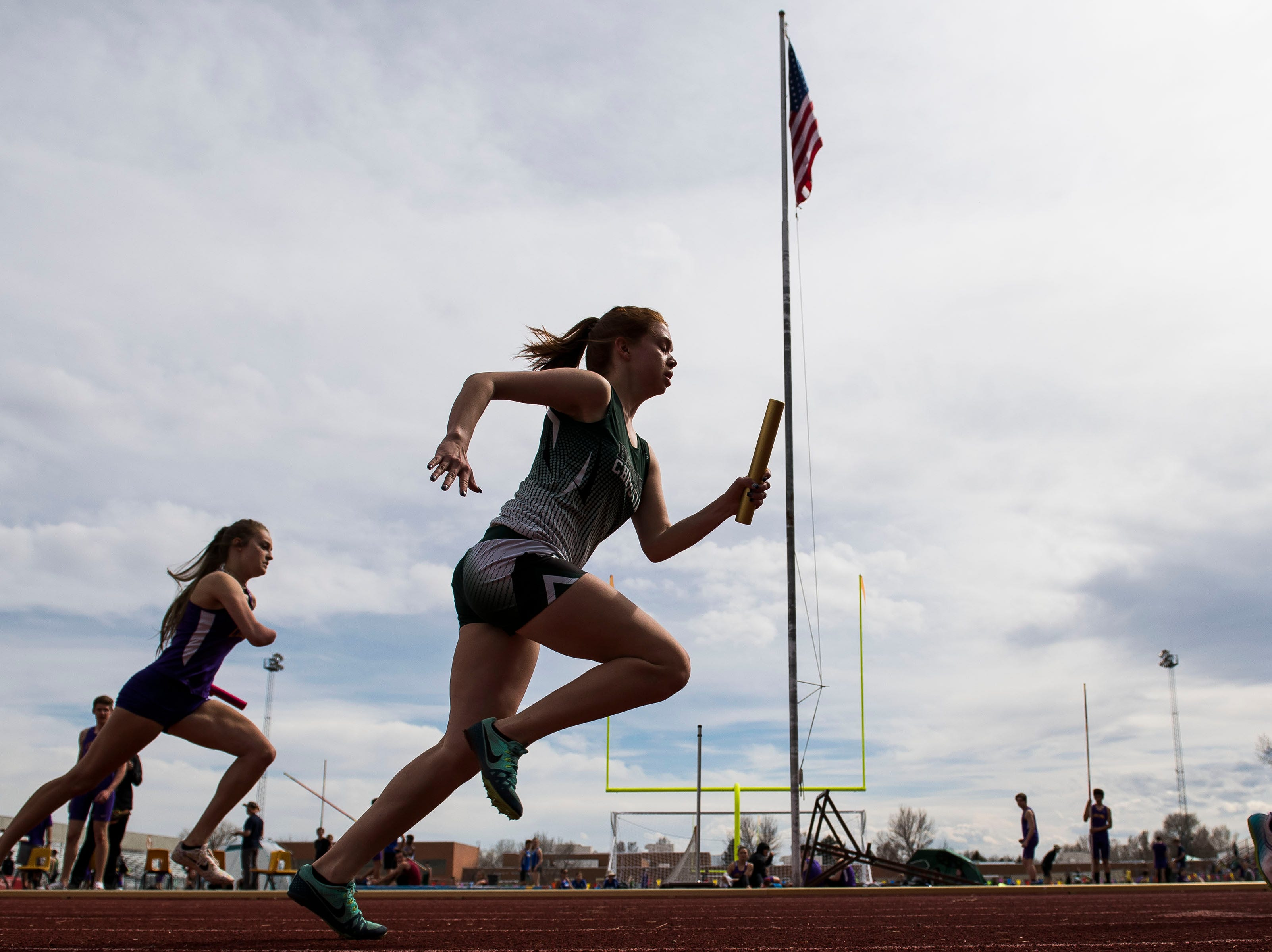 Heritage Christian's Lizzy Gueck competes in the 4x200 relay during the Randy Yaussi City Track Championships on Tuesday, April 9, 2019, at French Field in Fort Collins, Colo.