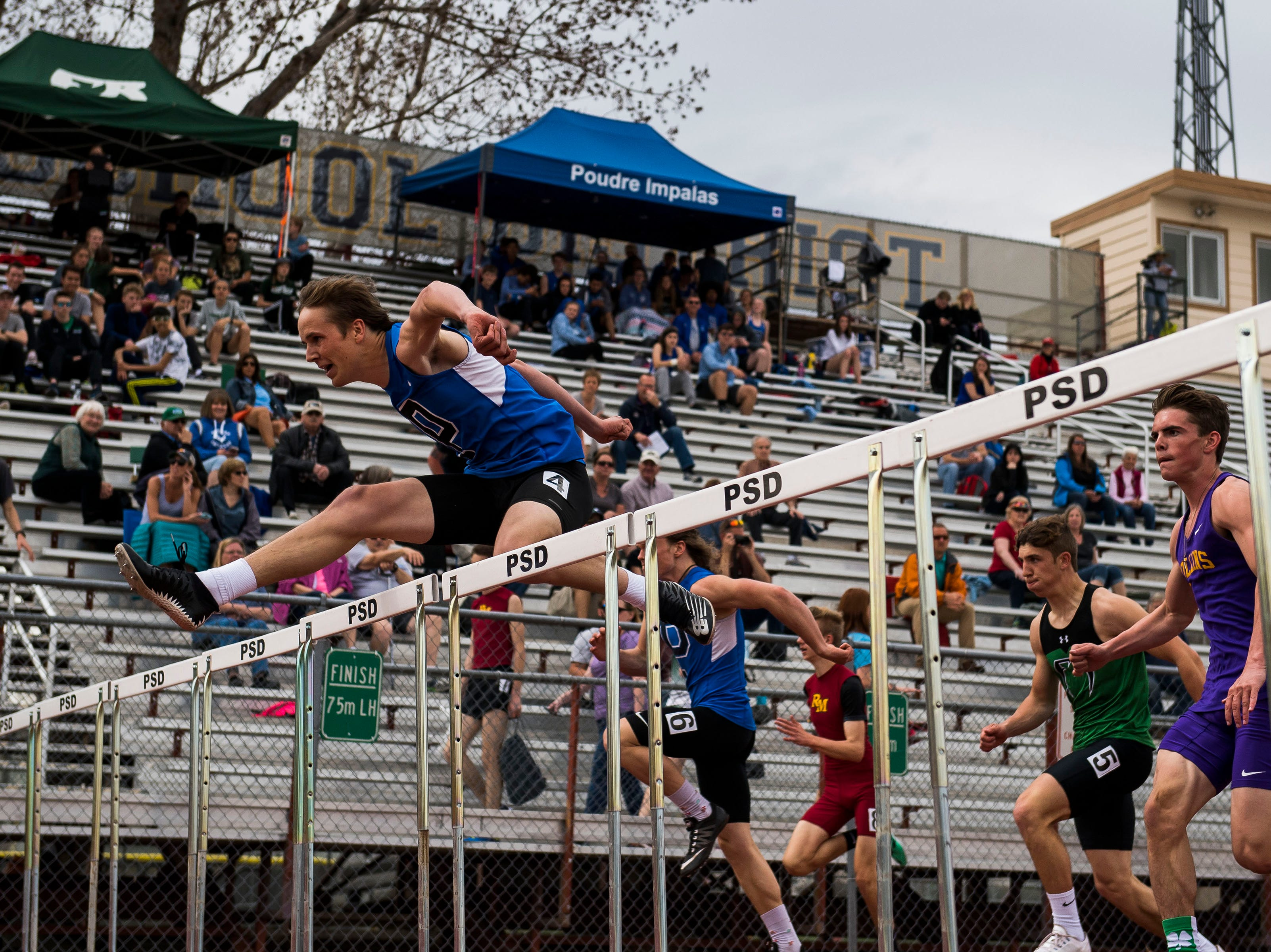 Poudre's Hunter Greenlee leads his heat in the boys 110-meter hurdles during the Randy Yaussi City Track Championships on Tuesday, April 9, 2019, at French Field in Fort Collins, Colo.