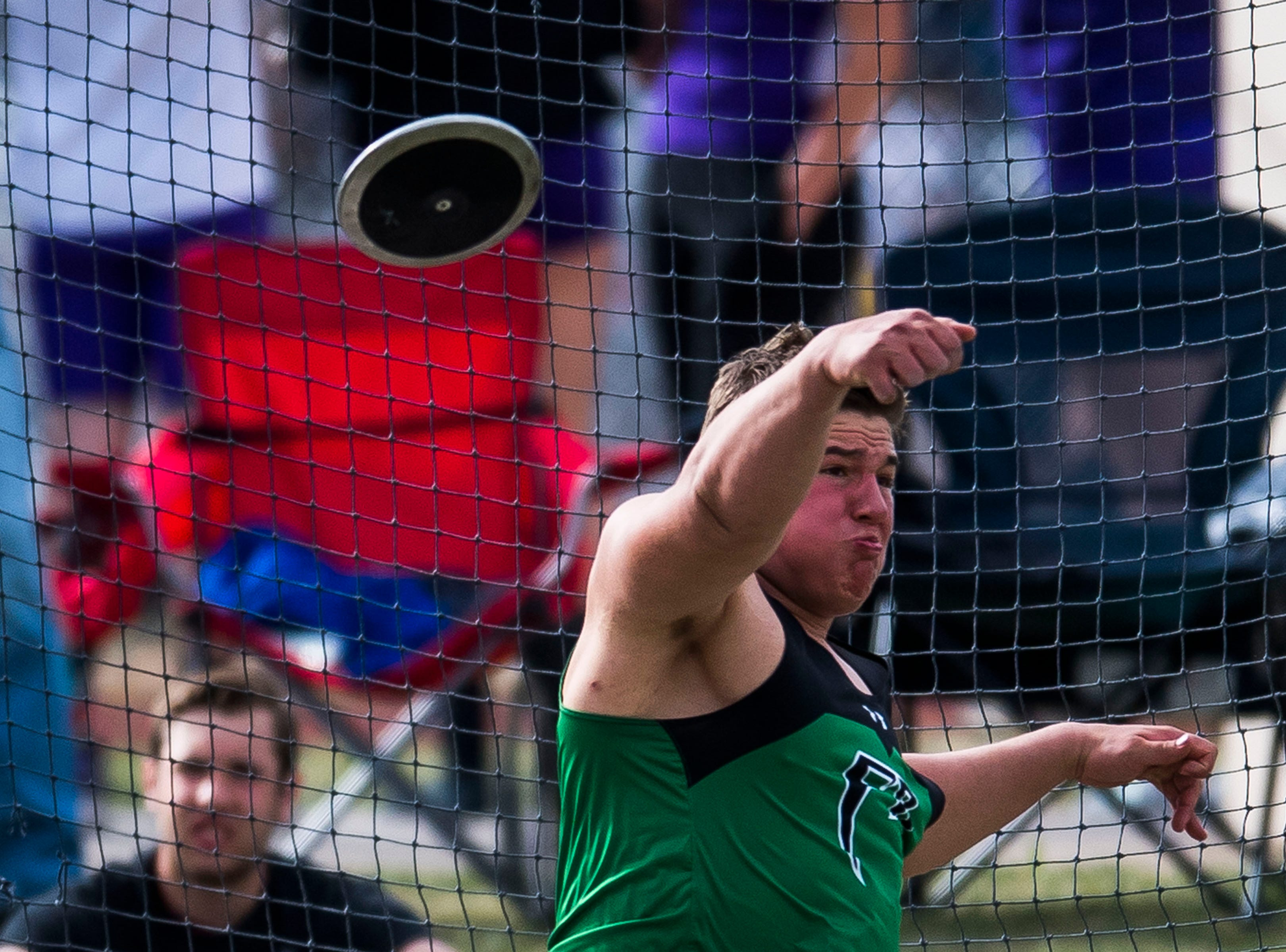 Fossil Ridge's Zach Heckman competes I the discus during the Randy Yaussi City Track Championships on Tuesday, April 9, 2019, at French Field in Fort Collins, Colo.