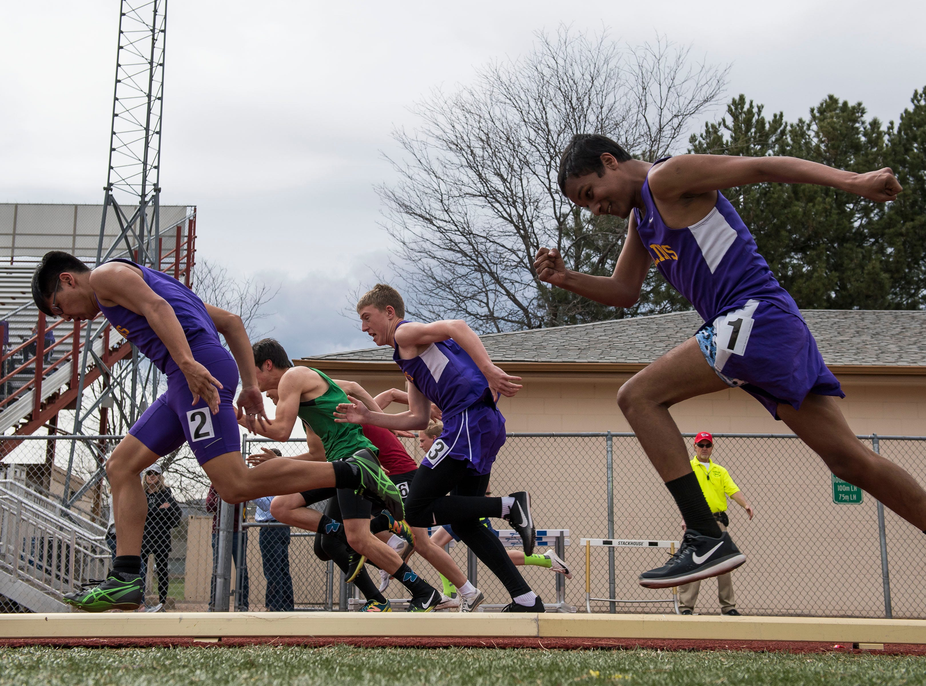 Local boys compete in the boys 100-meter dash during the Randy Yaussi City Track Championships on Tuesday, April 9, 2019, at French Field in Fort Collins, Colo.