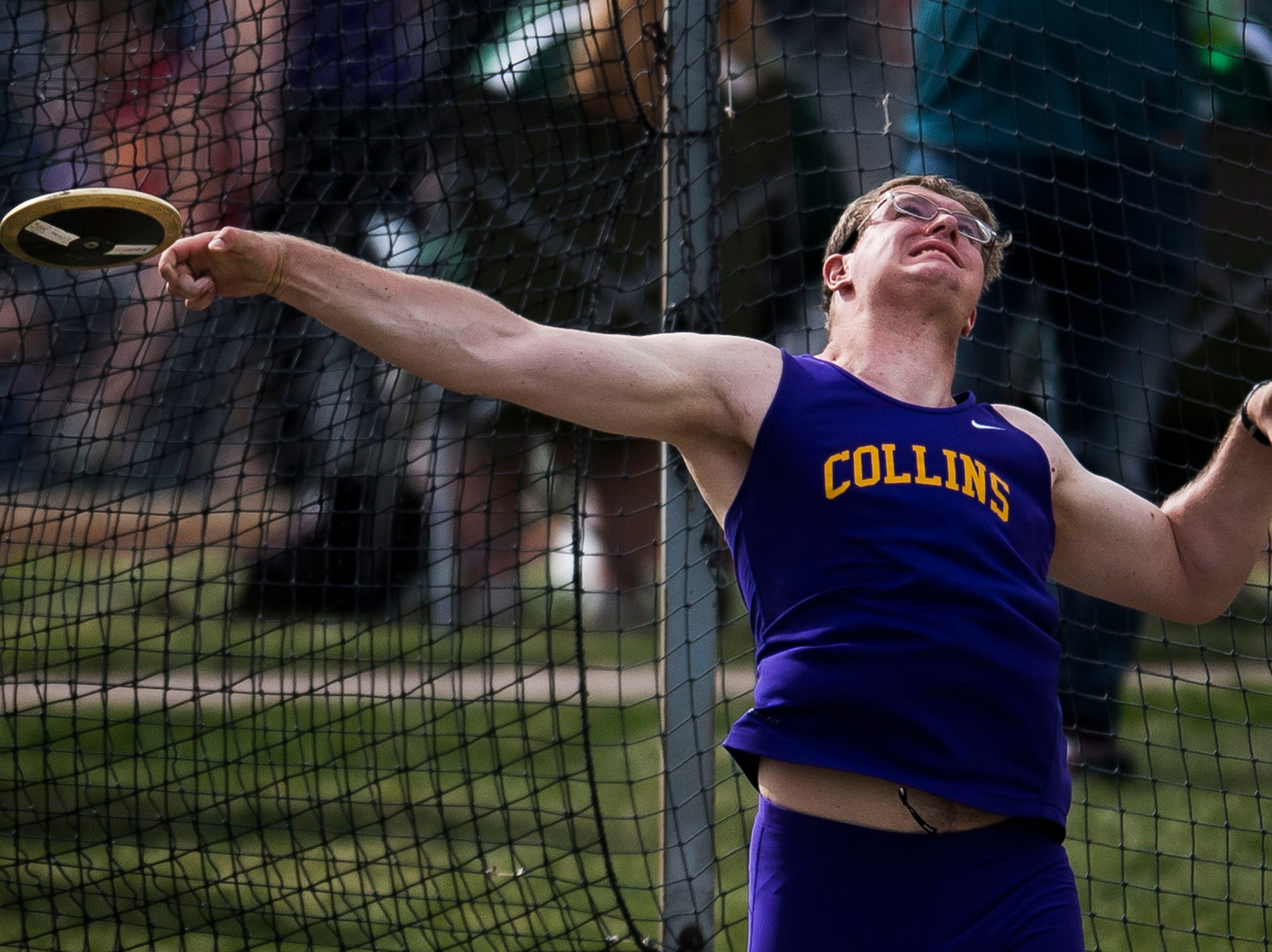 Fort Collins High School senior Joshua Rudd competes in the discus throw during the Randy Yaussi City Track Championships on Tuesday, April 9, 2019, at French Field in Fort Collins, Colo.