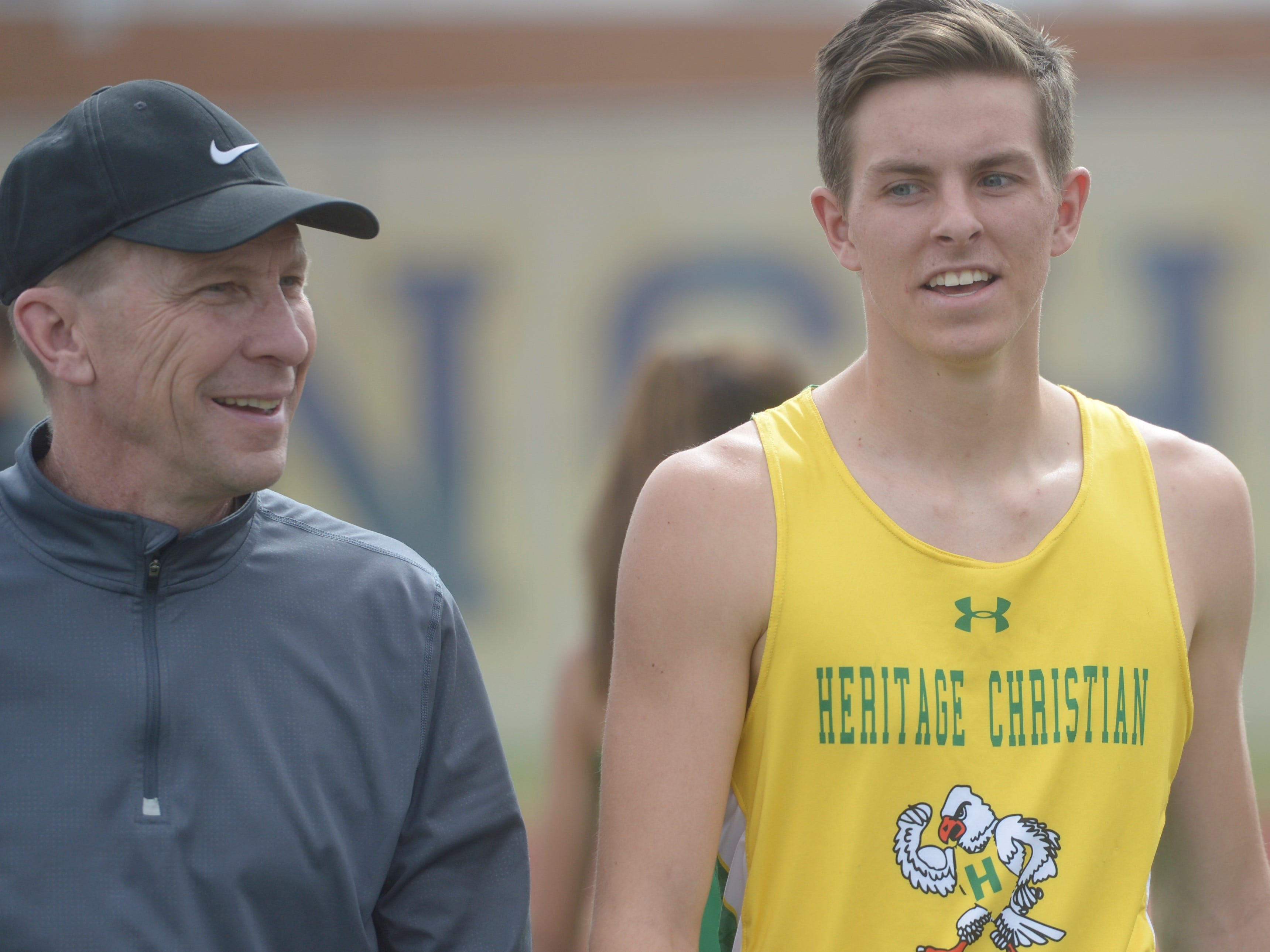 Heritage Christian's Josiah Bowsher, right, talks with athletic director Kevin McGinley at the Fort Collins city meet at French Field on Tuesday, April 9, 2019.