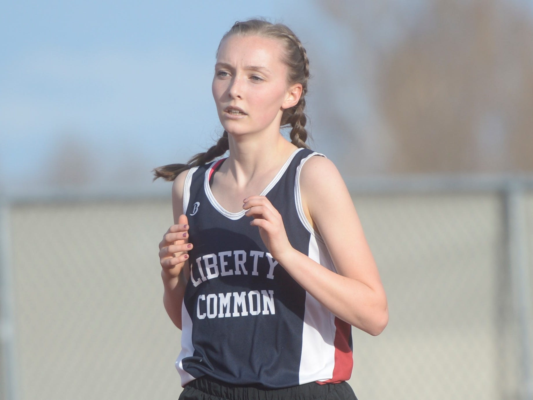Liberty Common's Josie Doman competes in the 3,200 run at the Fort Collins city meet at French Field on Tuesday, April 9, 2019.