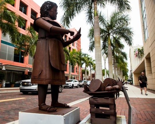The statues in downtown Fort Myers sculpted by Columbian artist Edgardo Carmona were bought by the City of Fort Myers last fall. They were supposed to be a temporary exhibit.