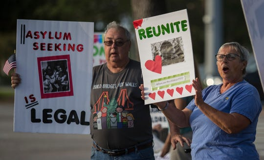 Gabrielle Spuckes, right, and Steve Sherman were part of a group of people rallying on the corner of Cape Coral Parkway and Del Prado Blvd. Wednesday morning, April 10, 2019. The rally sought to bring awareness to ongoing family separations taking place at places such as the privately owned detention center located in Homestead, FL.