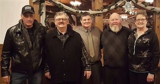 "From left, honorees as the fifth annual PAWS Hall of Fame Banquet on March 8 were Matt Morrissey, who accepted for his son Jake Morrissey, Nick ""The Bear"" Kinziger, who founded the Oconto Falls wrestling program, Dick Jahnke, and John and Patsy Senn."