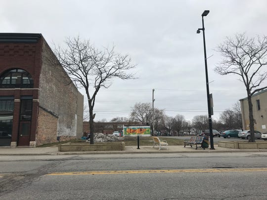 An Iowa firm wants to redevelop the vacant, grassy lot at 321-325 N. Broadway into a mixed-use building. The lot is located between Creative Business Services and Three Three Five.