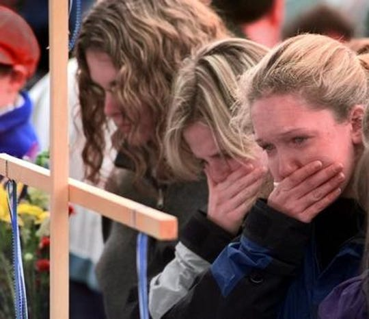 Students choke back tears at a memorial for the victims of the 1999 Columbine High School massacre.