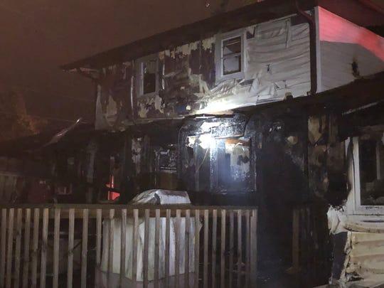 The backside of an Ashwaubenon duplex after an early morning fire.