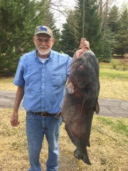 Larry Westmoreland of Walhalla shows off the 89-pound blue catfish he caught at Lake Keowee.