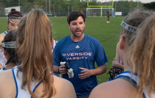 Riverside coach Thomas Riley talks to the team during half-time of the game against Spartanburg at Riverside High School Tuesday, April 9, 2019.