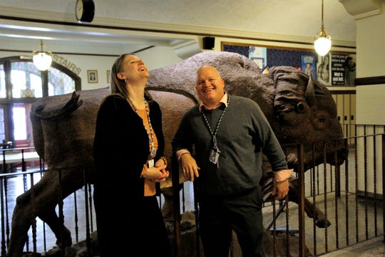Great Falls High Principal Heather Hoyer and Geoff Habel, the school's next principal, share a laugh in front of the school's bison. Hoyer is moving to become the associate superintendent of Great Falls Public Schools.