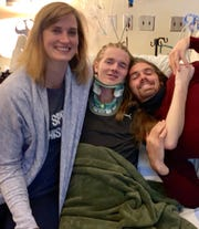 Jack Racicot, center, is visited in the hospital by cousin Jordan Bagley, left and brother Wil.