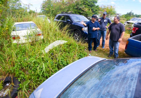 Lease holder David Janz, right, meets with Chamorro Land Trust Commission Administrative Director Jack Hattig III, center, and Department of Land Management Land Agent Glenn Eay during a compliance inspection in Dededo on Wednesday, April 10, 2019.