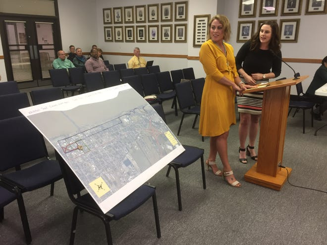 Lindsay Locasto and Abby Dixon explain the concept of Downtown Discovery Trails to city officials Tuesday evening.