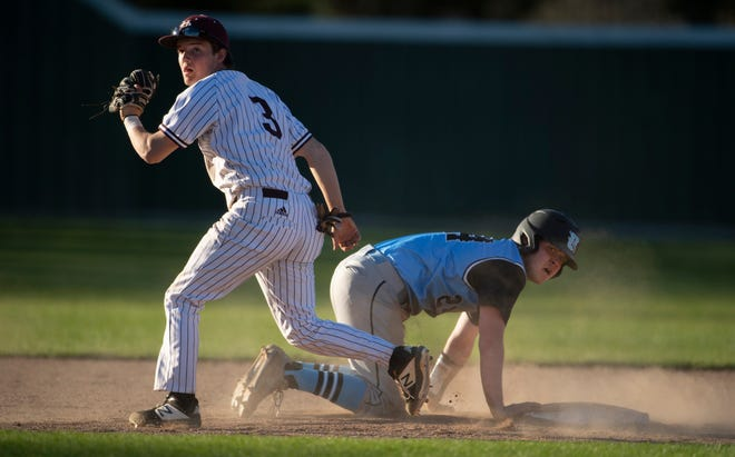 Henderson County's Colton Evans (3) looks to the umpire for the call after tagging Union County's Coy Burns (24) out at second base after he took too big of a lead during their game at B.T. Wayne Field Tuesday evening.