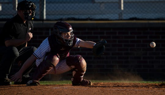 Henderson County's Seth Givens (6) receives a pitch during their game against Union County at B.T. Wayne Field Tuesday evening.