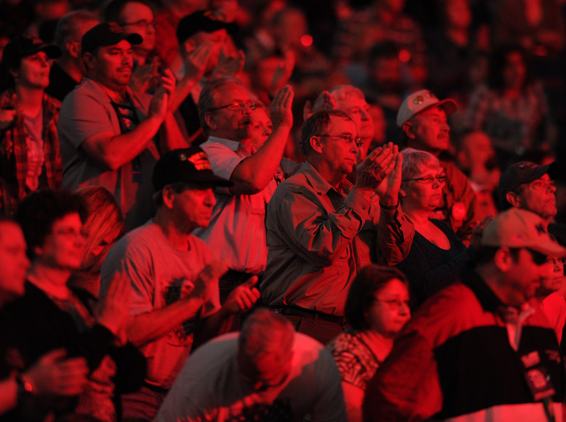 The crowd gives Wayne LaPierre, executive vice president of the NRA, a standing ovation at the NRA Stand and Fight Rally during the 143rd National Rifle Association Annual Meeting at Lucas Oil Stadium, Saturday, April 26, 2014, in Indianapolis.