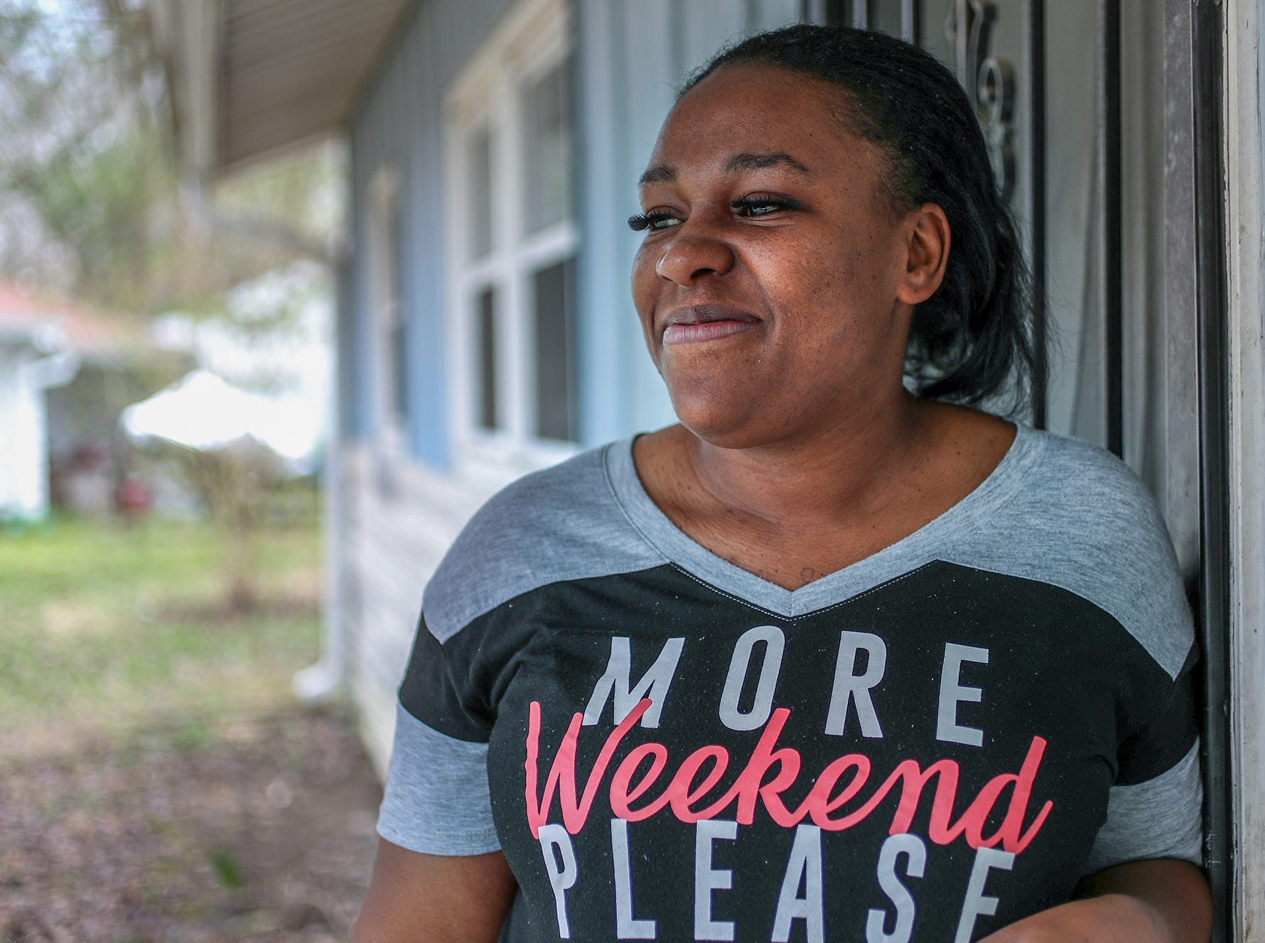 Latasha Sanders steps outside a family friend's home on Wednesday, April 10, 2019. Sanders and her family are residing at the Indianapolis residence until she can find permanent housing.