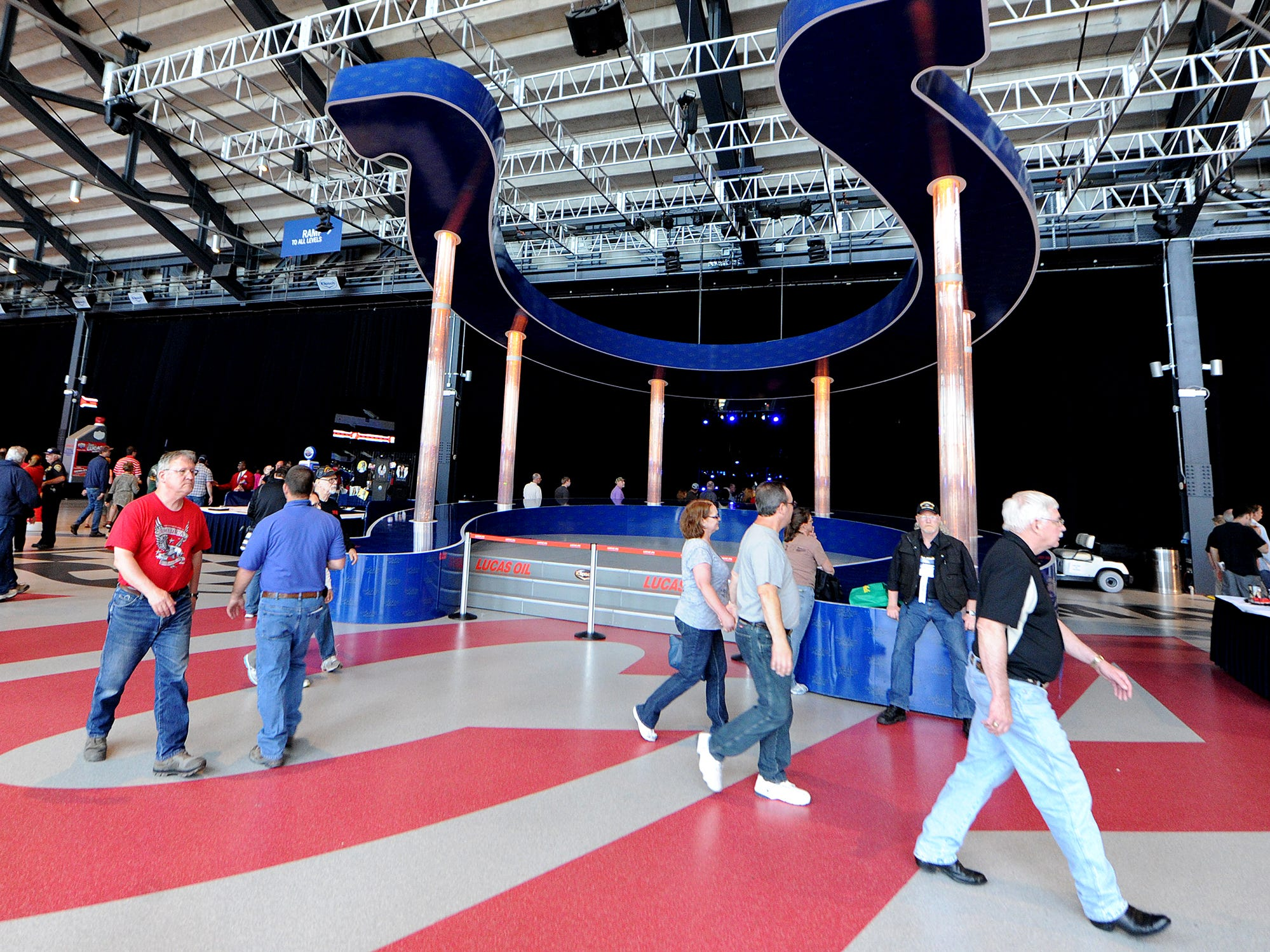 Visitors walk past the Indianapolis Colts horseshoe at the NRA Stand and Fight Rally during the 143rd National Rifle Association Annual Meeting at Lucas Oil Stadium, Saturday, April 26, 2014, in Indianapolis.
