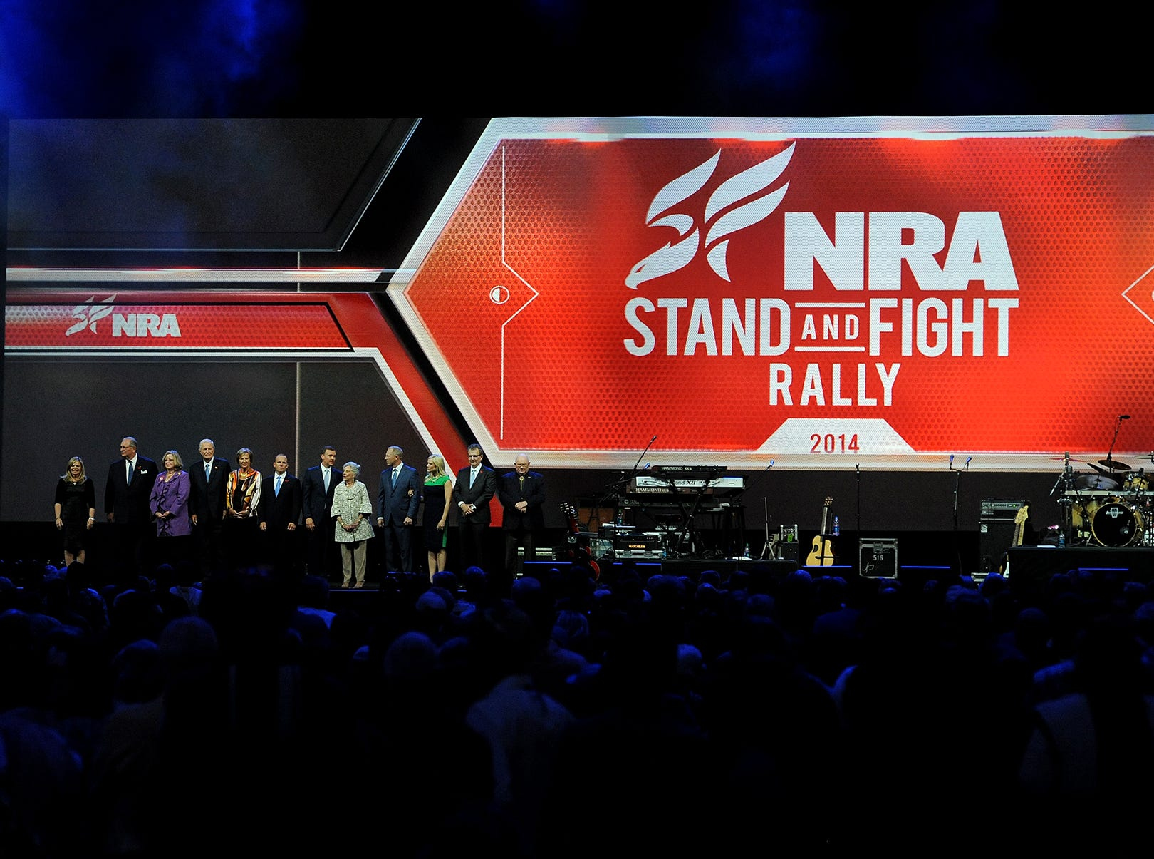 The NRA officers take the stage at the NRA Stand and Fight Rally during the 143rd National Rifle Association Annual Meeting at Lucas Oil Stadium, Saturday, April 26, 2014, in Indianapolis.