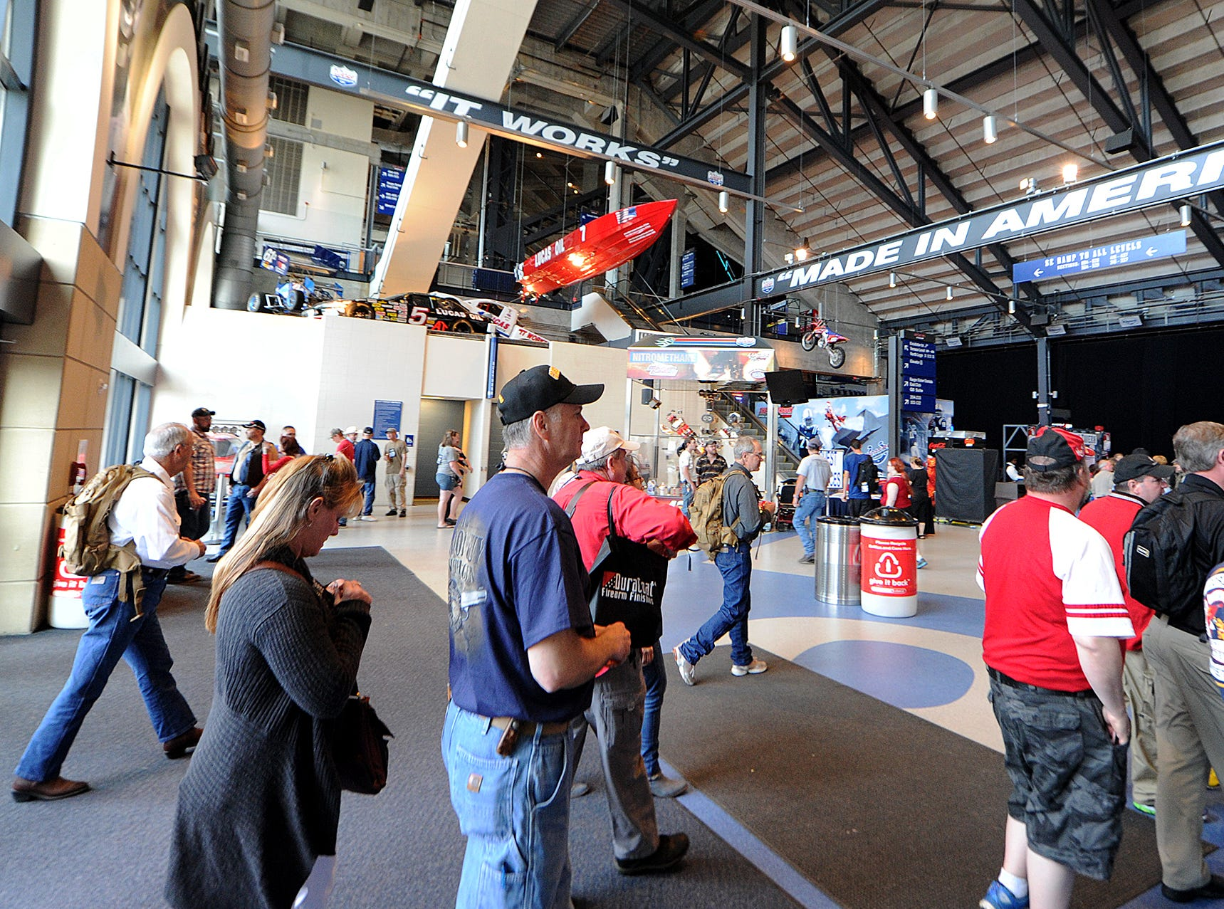 "Guests walk under a ""Made in America"" beam as they enter the NRA Stand and Fight Rally during the 143rd National Rifle Association Annual Meeting at Lucas Oil Stadium, Saturday, April 26, 2014, in Indianapolis."