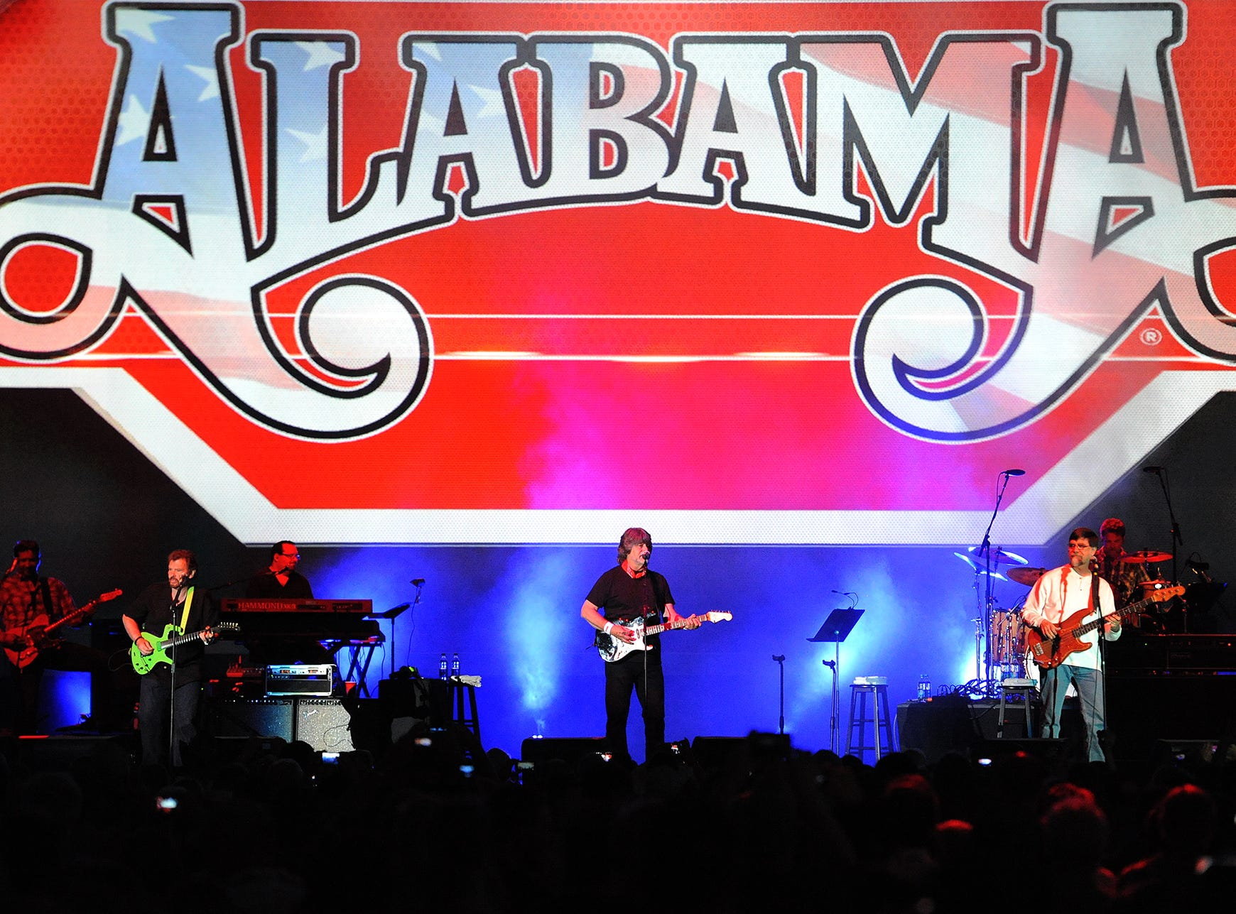 Country music artists Alabama perform at the NRA Stand and Fight Rally during the 143rd National Rifle Association Annual Meeting at Lucas Oil Stadium, Saturday, April 26, 2014, in Indianapolis.