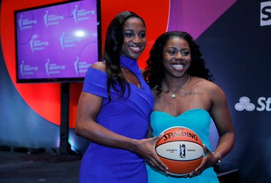 Notre Dame's Jackie Young, left, and Arike Ogunbowale pose for photos before the WNBA basketball draft Wednesday, April 10, 2019, in New York.
