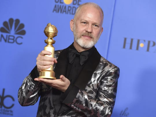 "Warren Central High School alum Ryan Murphy poses with the Golden Globe for best television limited series for ""The Assassination of Gianni Versace: American Crime Story"" awarded Jan. 6 in Los Angeles."