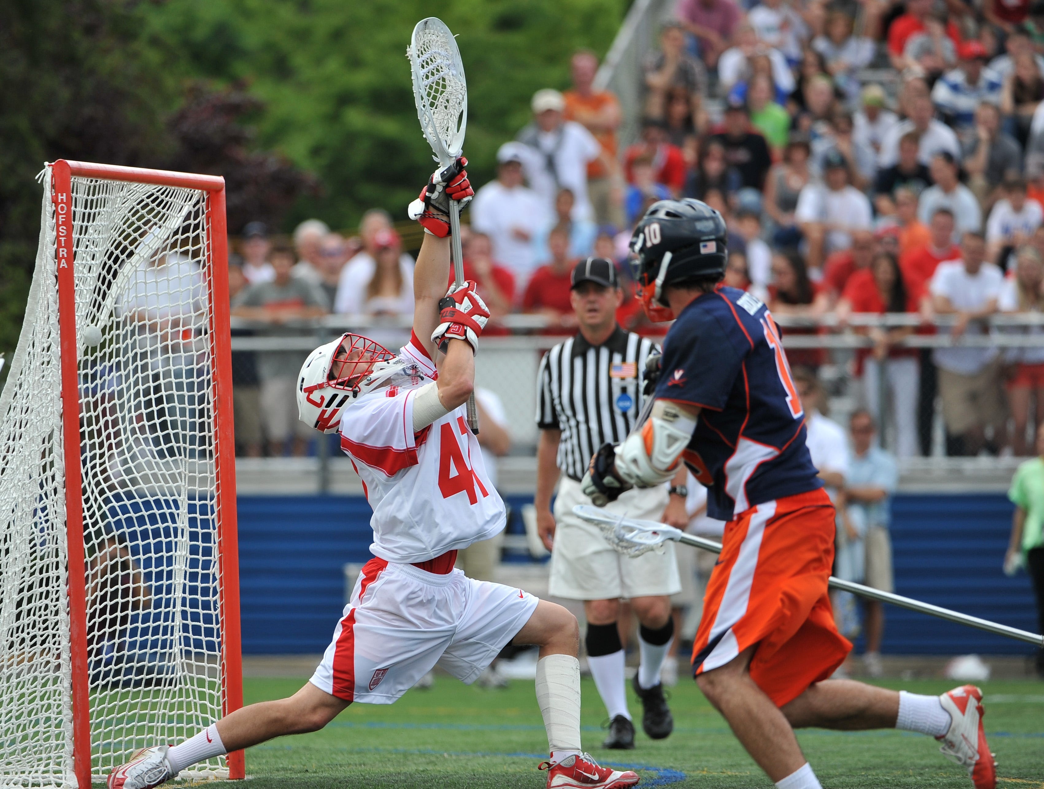 Virginia's Chris Bocklet (10) fires the ball past Cornell goalie AJ Fiore for a goal in the second quarter of an NCAA Division I men's lacrosse tournament quarterfinal at Hofstra University on Saturday, May 21, 2011, in Hempstead, N.Y. Virginia won 13-9.