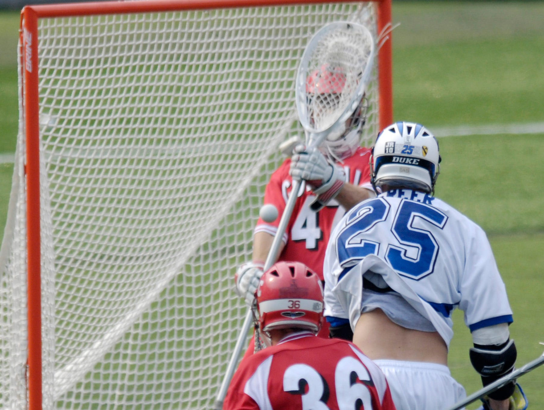 Duke's Zack Greer (25) scores the game-winning goal against Cornell goalie Matt McMonagle (47) as Mitch Belisle (36) looks on during closing seconds during a division one NCAA lacrosse semifinal game, Saturday, May 26, 2007, in Baltimore. Duke won, 12-11.