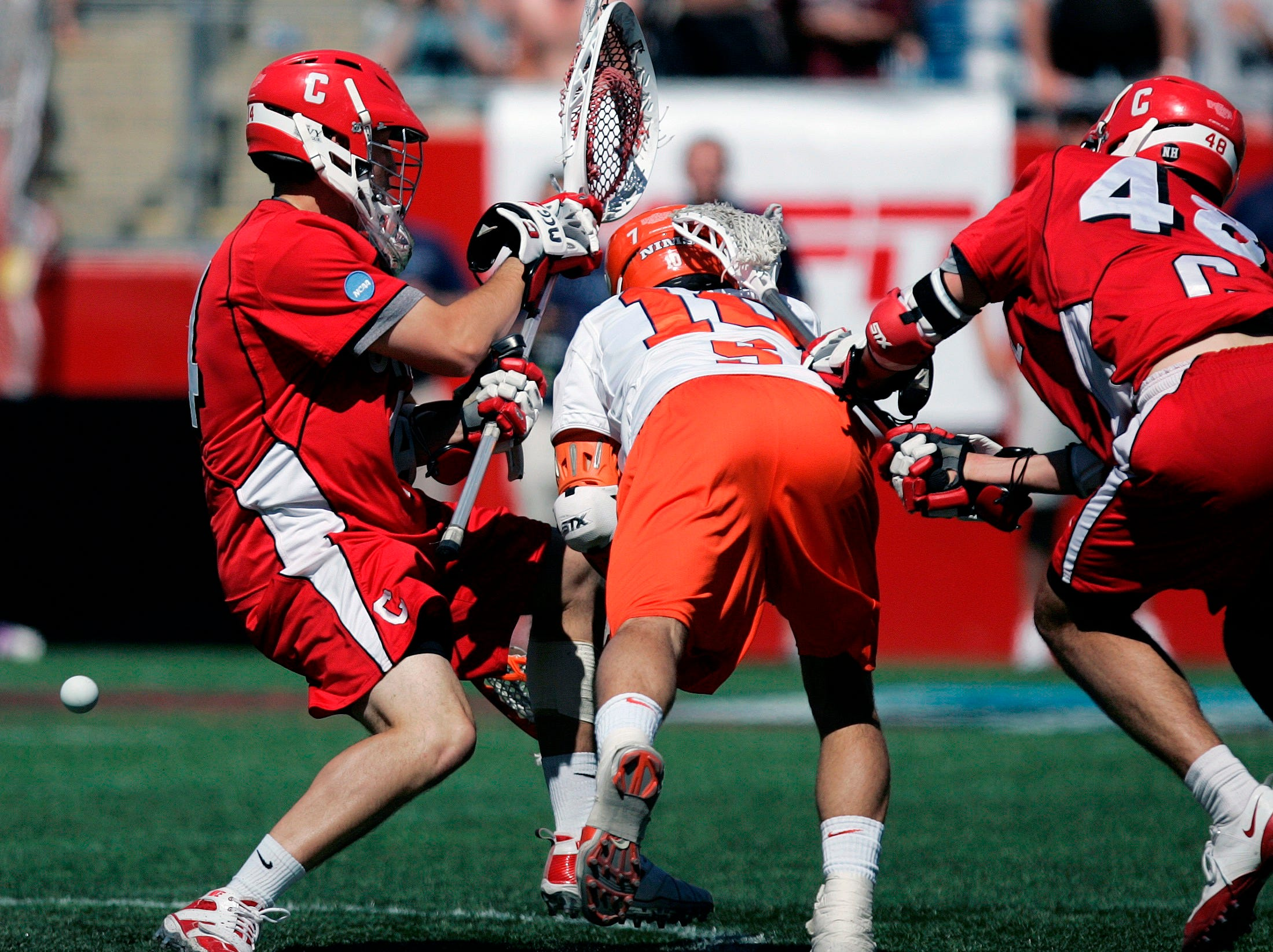 Syracuse's Kenny Nims, center, scores the game-tying goal against Cornell goalkeeper Jake Myers, left, in the fourth quarter of an NCAA Division I men's lacrosse championship game in Foxborough, Mass., Monday, May 25, 2009. Syracuse won 10-9 in overtime.