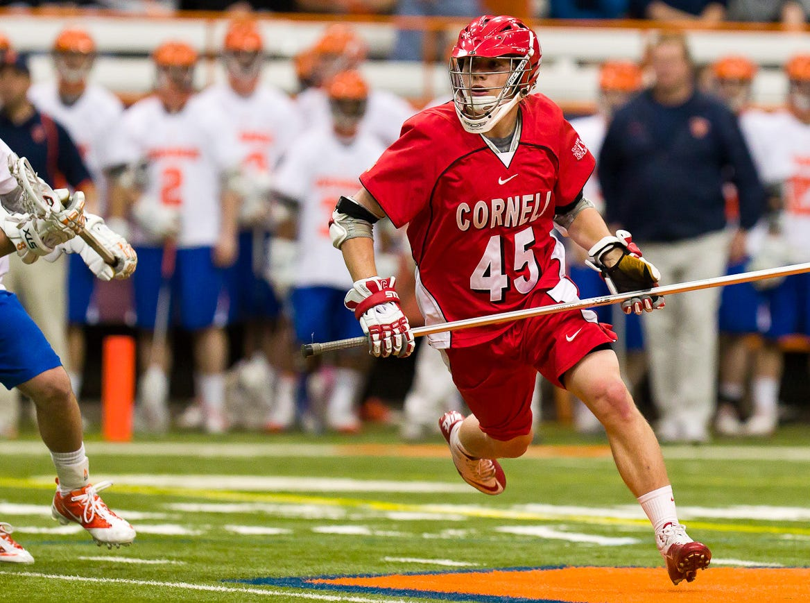 2011: Jason Noble looks to work the ball up field during the Big RedÕs game at Syracuse on April 10. Noble, an All-America long-stick defender, is the anchor of the seventh-ranked Big RedÕs defense.