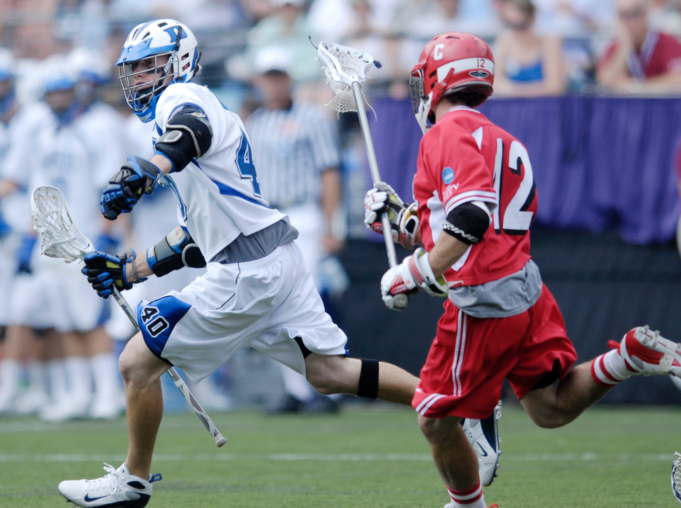 Duke's Matt Danowski (40) carries the ball past Cornell's Matt Moyer (12) during a division one NCAA lacrosse semifinal game, Saturday, May 26, 2007, in Baltimore.