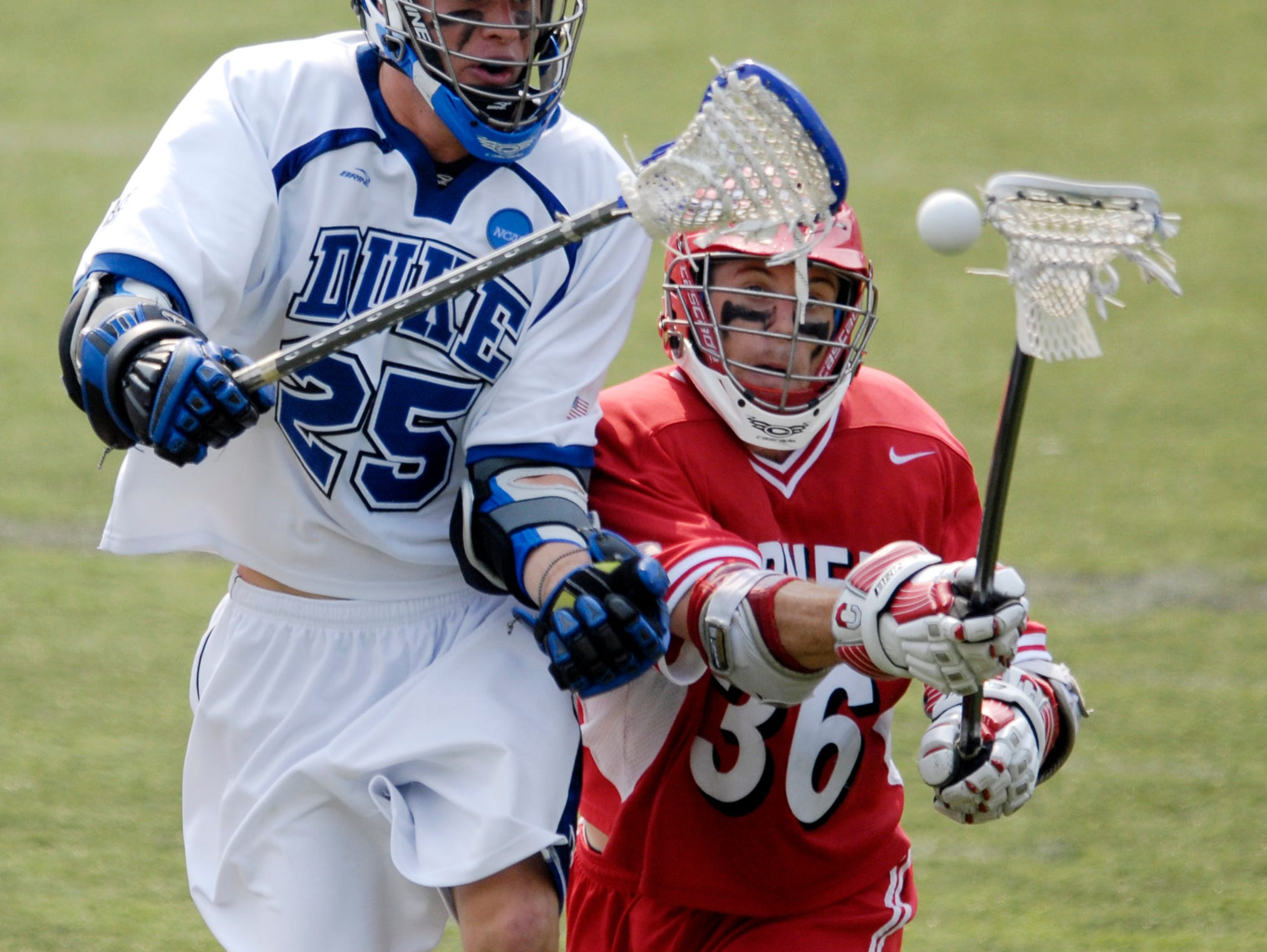Duke's Zack Greer (25) fights for the ball against Cornell's Mitch Belisle (36) during a division one NCAA lacrosse semifinal game, Saturday, May 26, 2007, in Baltimore. Duke won 12-11.