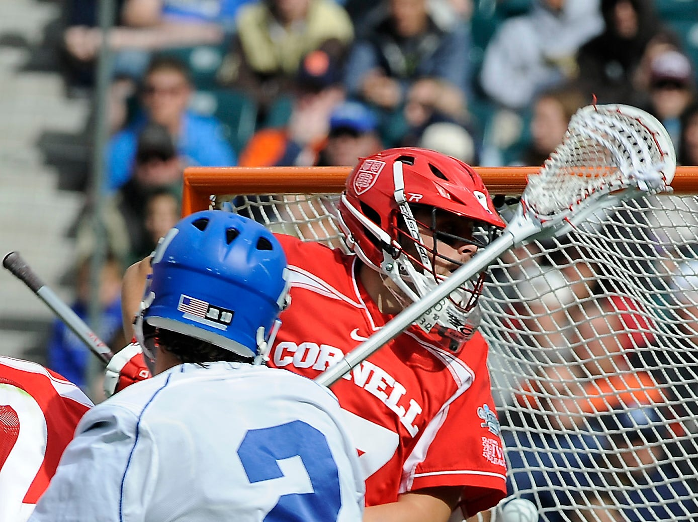 Duke's David Lawson (2) scores on Cornell's AJ Fiore (47) during the second half of an NCAA college Division 1 semifinal lacrosse game on Saturday, May 25, 2013, in Philadelphia. Duke won 16-14.