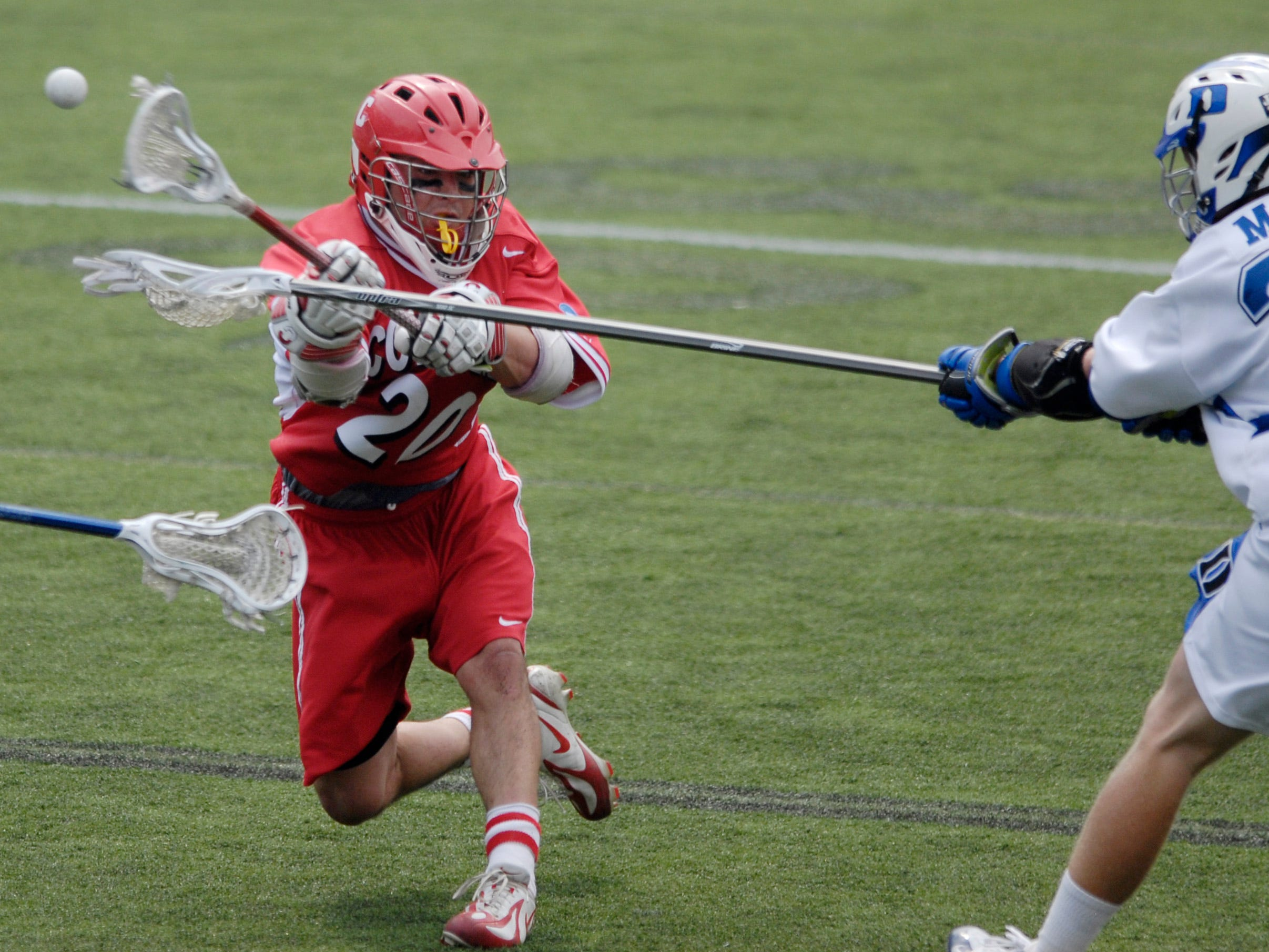 Cornell's John Glynn (20) takes a shot against Parker McKee (35) Duke's during a division one NCAA lacrosse semifinal game, Saturday, May 26, 2007, in Baltimore.