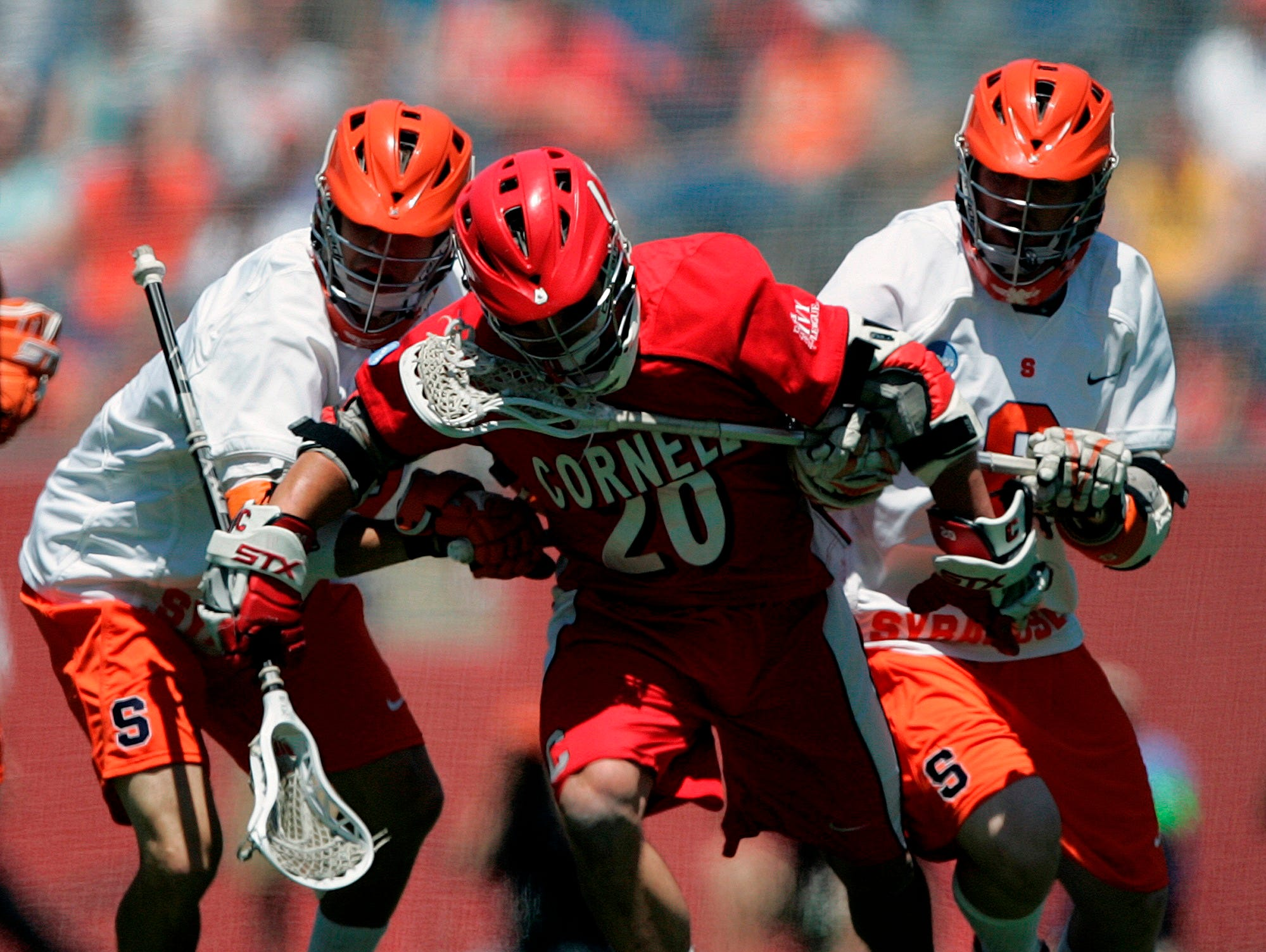 Cornell's John Glynn (20) battles Syracuse's Josh Amidon, left, and Jake Moulton for the loose ball in the first quarter of an NCAA Division 1 Men's lacrosse  championship game in Foxborough, Mass., Monday, May 25, 2009.