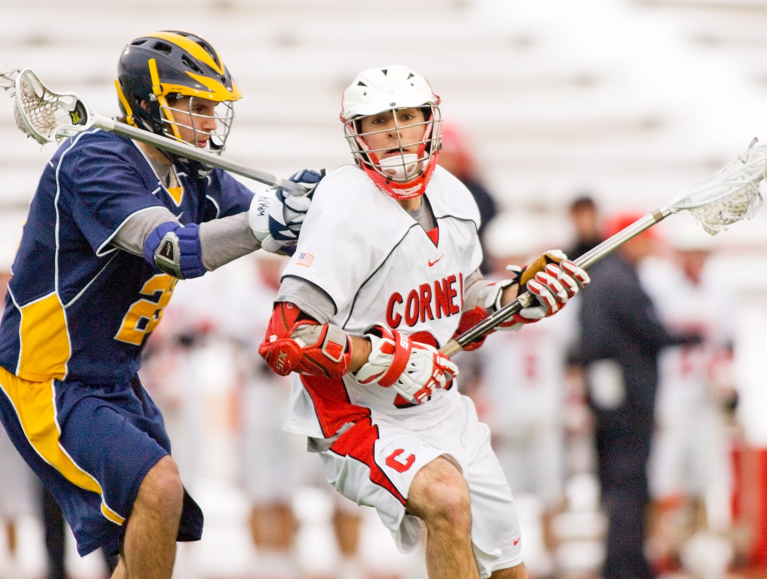 2011: Canisius' D.J. Giacobbo defends as Cornell's Scott Austin looks for a shot during the first half of their game Wednesday evening at Schoellkopf Stadium.