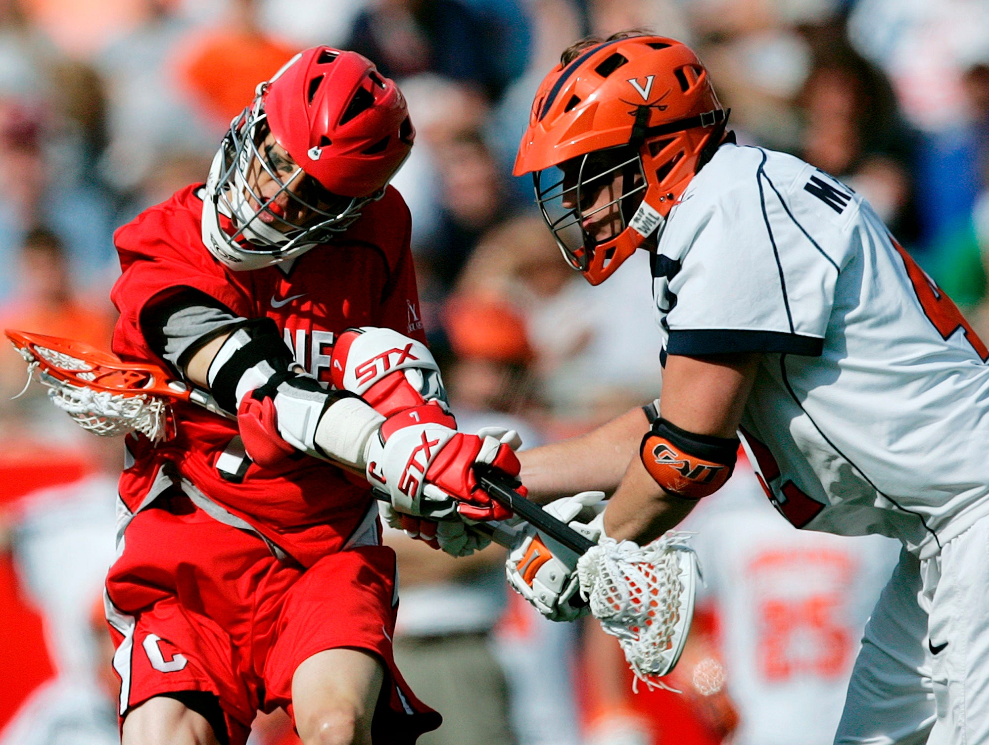 Virginia's Max Pomper, right, breaks up a shot by Cornell's David Lau in the third quarter of an NCAA Division 1 Men's lacrosse  semifinal game in Foxborough, Mass., Saturday, May 23, 2009. Cornell won 15-6.