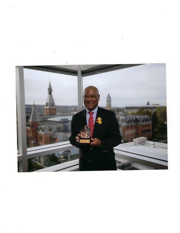 Tom Jones receiving the Frank Rhodes Exemplary Alumni Service Award from Cornell in September 2017.