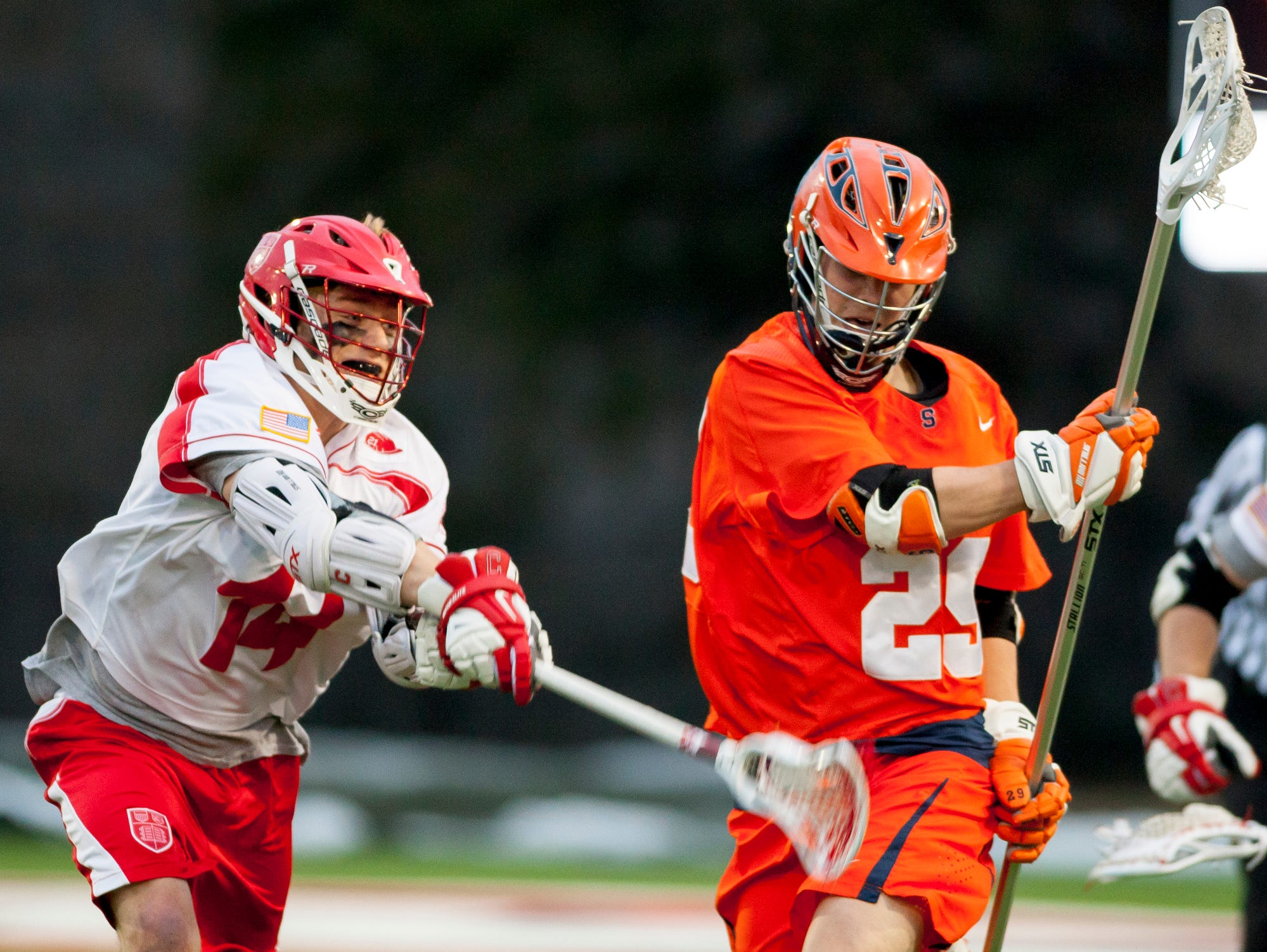 2014: Cornell's Dan Lintner left, tries to knock the ball away from Syracuse's Scott Firman during the first half of their game Tuesday evening at Schoellkopf Field in Ithaca.