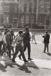Students march across the Arts Quad following the peaceful resolution to the Straight takeover, April 20, 1969.