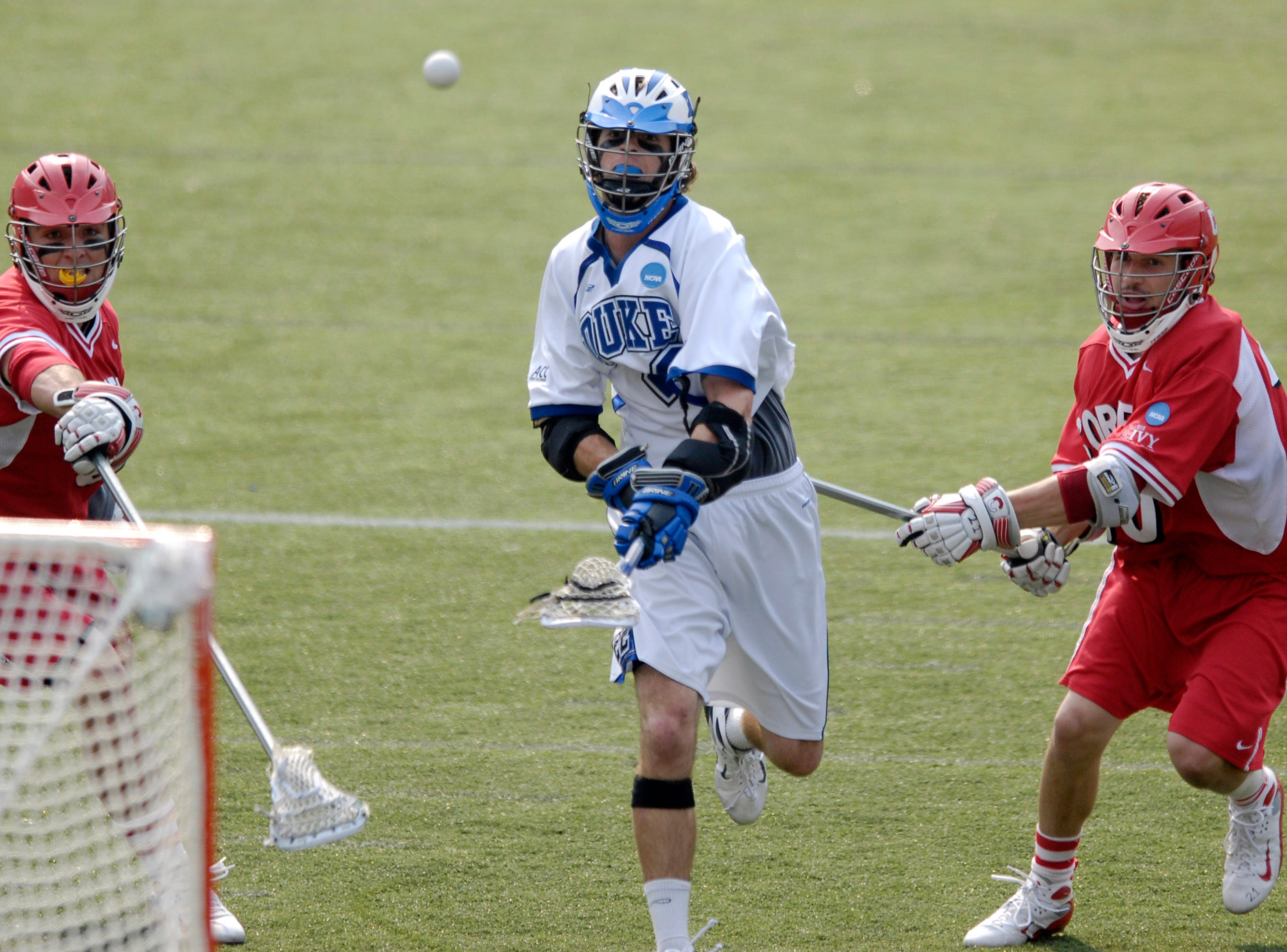 Duke's Ned Crotty, center, shoots and scores a goal between Cornell's Nick Gradinger, left, and George Calvert, right, during a division one NCAA lacrosse semifinal game, Saturday, May 26, 2007, in Baltimore. Duke won, 12-11.