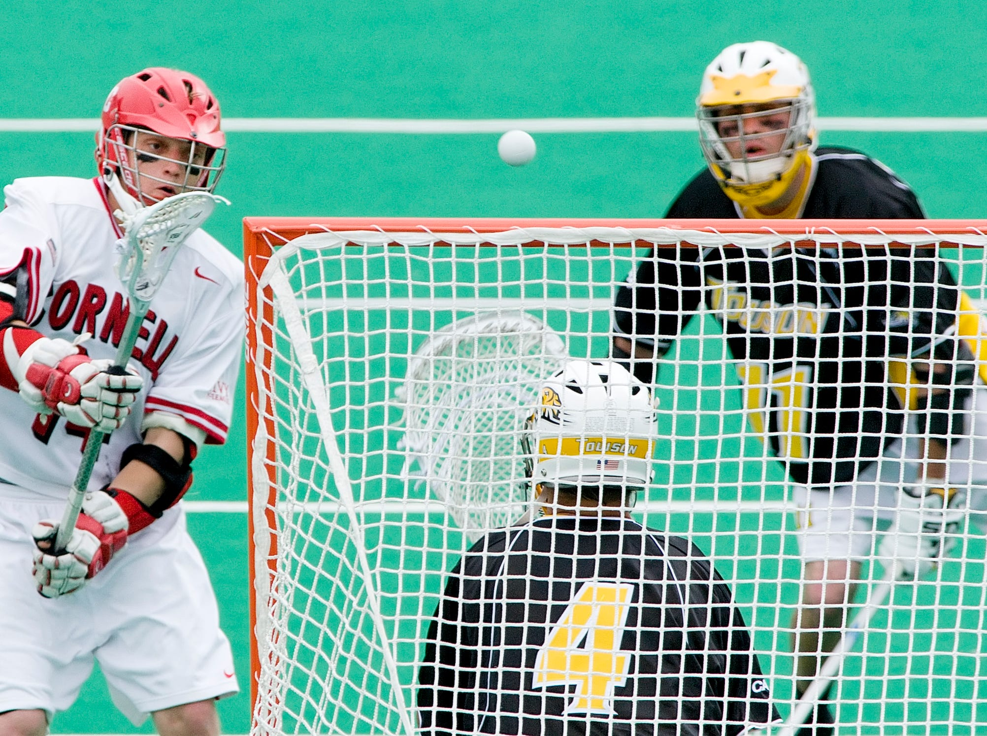 2007: Cornell's Henry Bartlett takes a shot as Towson goalie Billy Sadtler defends in the NCAA Div. 1 Championship first round game May 12 at Schoellkopf Field.