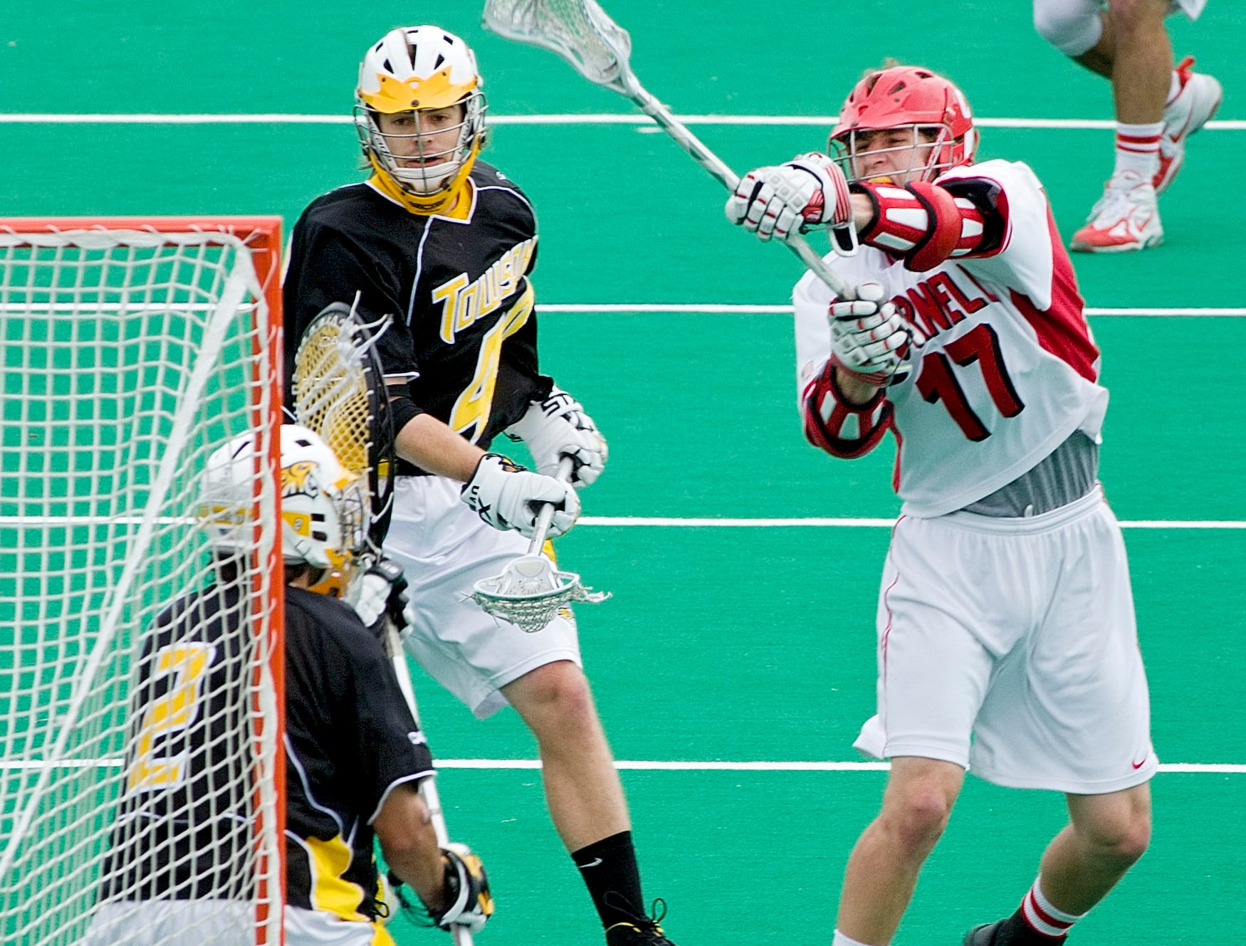 2007: Cornell's David Mitchell, 17, shoots a goal on Towson's Matt Antol in the first period of Saturday's NCAA Div. 1 Championship first round game at Schoellkopf Field.