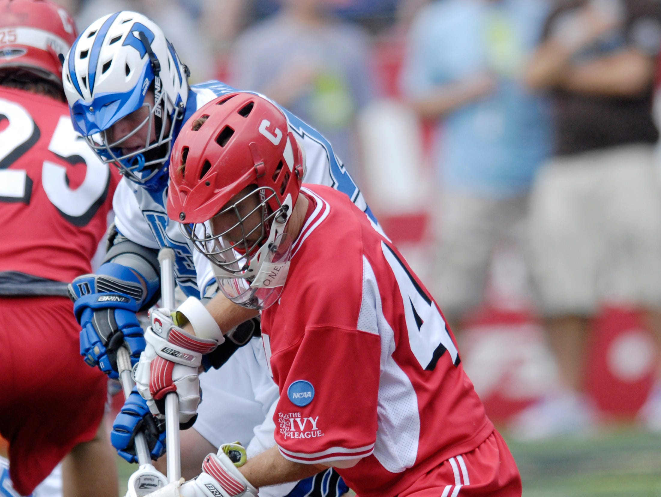 Duke's Max Quinzani, left, battles for the ball against Cornell's Matt McMonagle, right, during a division one NCAA lacrosse semifinal game, Saturday, May 26, 2007, in Baltimore.