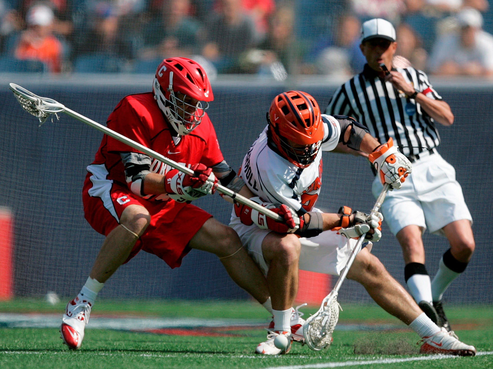 Virginia's Brian Carroll, right, keeps the ball inbounds against Cornell's Michael Howe, in the second quarter of an NCAA Division 1 Men's lacrosse  semifinal game in Foxborough, Mass., Saturday, May 23, 2009.