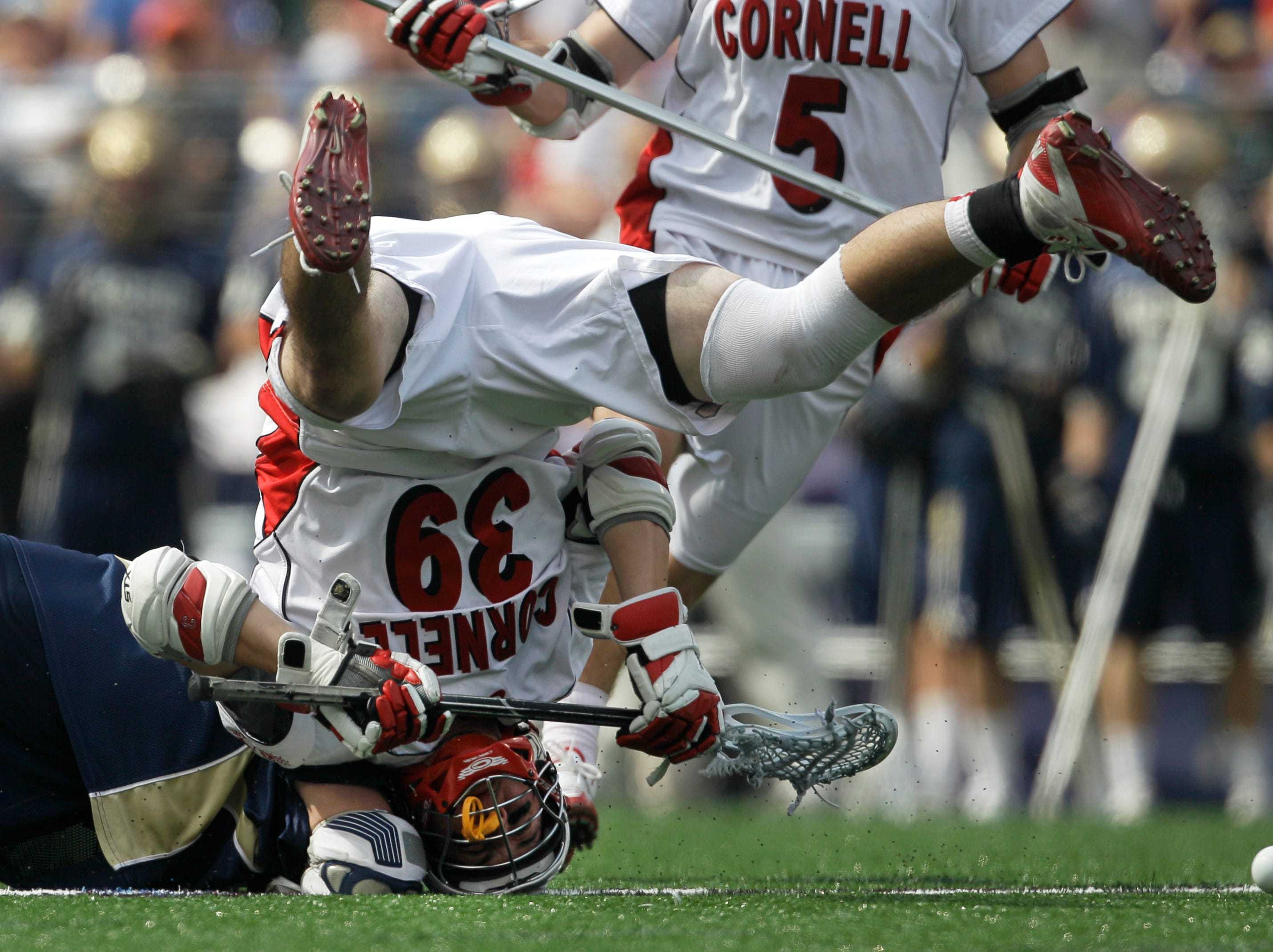 Notre Dame's Trever Sipperly, left, and Cornell's Austin Boykin (39) fight for the ball during a face off during the first half of the NCAA Men's Final Four semifinal lacrosse game, Saturday, May 29, 2010, in Baltimore.
