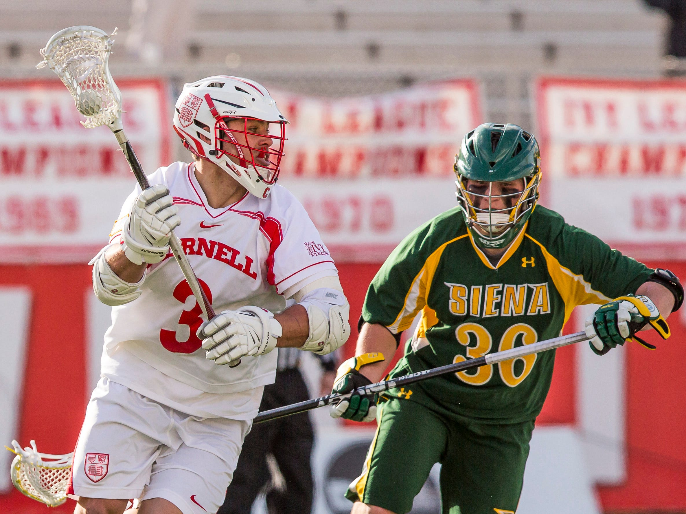 2013: Cornell senior Rob Pannell drives around Siena College sophomore Weston French Tuesday afternoon at Cornell's Schoellkopf Field. Cornell won 17 to 9.